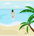 beach landscape with palm trees girl in a sea vector image vector image