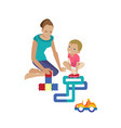 mom plays with child helping assemble constructor vector image