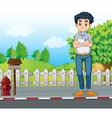 A man standing at the street near the wooden vector image vector image
