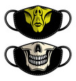 two designs fabric face mask with alien and skull vector image