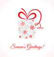 Greetings card with gift box made of snowflakes vector image vector image