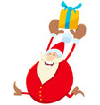 funny santa claus cartoon character with present vector image vector image