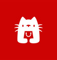 white cat hold shopping bag shop store logo icon vector image
