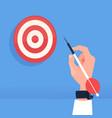 human hand holding arrow hit target dartboard vector image vector image