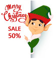 elf standing behind a sign and showing on placard vector image vector image