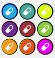 pill icon sign Nine multi colored round buttons vector image vector image