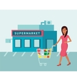 Woman in supermarket food shop with shopping cart vector image