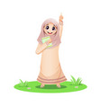 cute muslim girl pointing up with quran book vector image