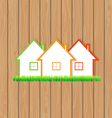 Houses for sale on the wooden background vector image vector image