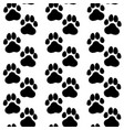 ink hand drawn seamless pattern with dog paws vector image vector image