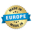 made in europe gold badge with blue ribbon vector image vector image