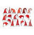 set doodle christmas hats on vintage paper vector image