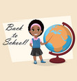 cute african american girl showing on globe vector image vector image