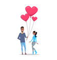man giving woman pink heart shape air balloons vector image vector image
