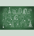 set of christmas hats on blackboard background vector image vector image