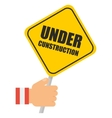 hand with under construction sign vector image vector image