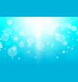 abstract bokeh and snowflakes in blue background vector image vector image