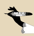 black silhouette female hand holding a feather vector image vector image