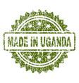 grunge textured made in uganda stamp seal vector image vector image