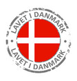 made in denmark flag grunge icon vector image