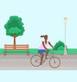 a woman riding a bike in a park in city vector image vector image