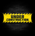 under construction banner on black vector image