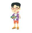 little asian boy eating vegetable salad vector image