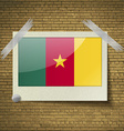 Flags cameroon at frame on a brick background vector image vector image