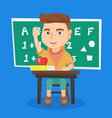 schoolboy raising hand while sitting at the desk vector image vector image