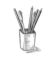 Office supplies pens and pencils in cup