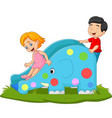 little kids playing on elephant slide vector image vector image