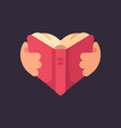 hands holding a book in the shape of a heart love vector image