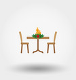 table with christmas decorations icon vector image