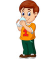 cartoon boy drinking milk vector image vector image