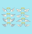 flying angel wings with gold nimbus set vector image vector image