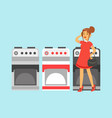 young woman choosing an electric stove in home vector image vector image