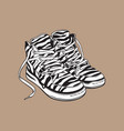 pair of zebra patterned sneakers sport shoes from vector image vector image