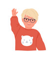 Little boy waving smiling and saying hi or bye