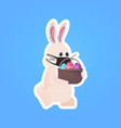 rabbit in mask holding basket with eggs happy vector image vector image