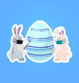 rabbits in masks drawing on egg happy easter vector image vector image