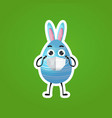blue decorated egg with rabbit ears in medical vector image vector image
