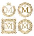 Golden letter m vintage monograms set heraldic vector image