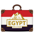 travel suitcase with egyptian flag and sphinx vector image vector image