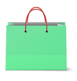 Classic paper shopping green bag with red grips