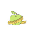 green apple with measuring tape icon vector image