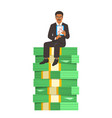 successful businessman sitting on a stack of money vector image