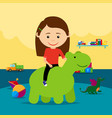 girl riding rubber toy in kindergarten vector image