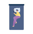 man lying in bed using mobile phone at night flat