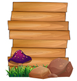 Wooden signboards with a mushroom and rocks at the vector image vector image