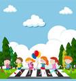 many children crossing street vector image